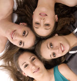 Group of woman lying on the floor. Four youg woman on a white background Stock Image
