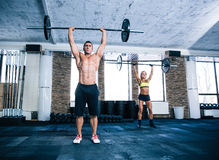 Group of woman and man workout with barbell Royalty Free Stock Image