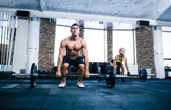 Group of woman and man workout with barbell Royalty Free Stock Photos