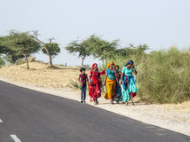 A Group of Woman walking at the Roadside of a Street to Pushkar, India Stock Images