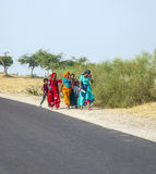 A Group of Woman walking at the Roadside of a Street to Pushkar, India Stock Photo