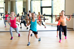 Group of women with barbells in gym Stock Images