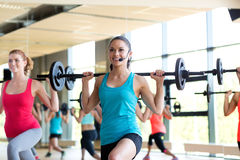 Group of women with barbells in gym Royalty Free Stock Images