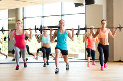 Group of women with barbells in gym Royalty Free Stock Photos