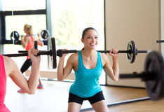 Group of women with barbells in gym Stock Photo