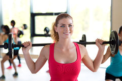 Group of women with barbells in gym. Fitness, sport, training and lifestyle concept - group of woman with barbells in gym Royalty Free Stock Photos