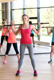 Group of women with bars in gym Royalty Free Stock Photography