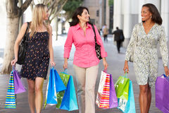 Group Of Women Carrying Shopping Bags On City Street Royalty Free Stock Photo