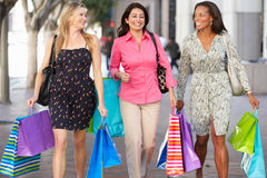 Group Of Women Carrying Shopping Bags On City Street. Smiling stock image