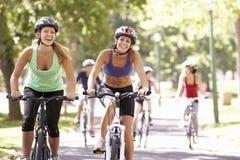 Group Of Women On Cycle Ride Through Park Stock Photos