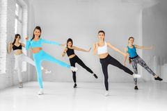 A group of women dancing in the gym. The concept of sports, a healthy lifestyle, fitness, stretching and dancing.  stock images