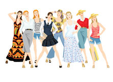 Group of women in different style of clothes. Royalty Free Stock Image