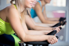 Group of women doing cycling cardio training Royalty Free Stock Photos