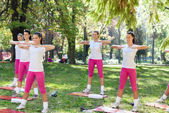 Group of women doing exercise Stock Photo
