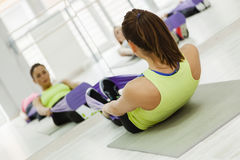 Group Of Women Doing Exercises With Gym Tensile Stock Photography