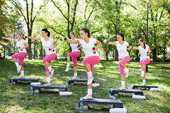 Group of women doing exercises, outdoo Stock Photos