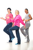 Group of women doing fitness. Group of three women doing fitness and smiling over white background Stock Images