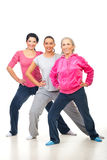 Group of women doing fitness. Group of three cheerful women doing fitness over white background Stock Photos