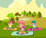 Group of women doing yoga in the park Stock Image