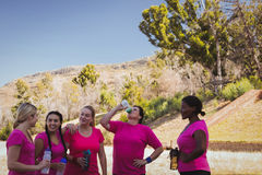 Group of women drinking water in the boot camp. On a sunny day royalty free stock photo