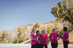 Group of women drinking water in the boot camp. On a sunny day royalty free stock images