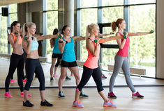 Group of women with dumbbells in gym Stock Photo