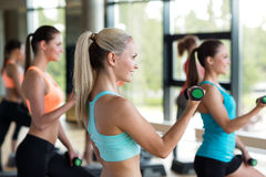 Group of women with dumbbells and steppers Royalty Free Stock Photography
