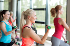 Group of women with dumbbells and steppers Royalty Free Stock Image