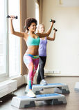 Group of women with dumbbells and steppers Stock Photography