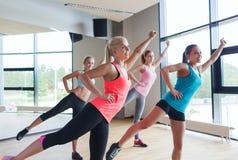 Group of women ecxercising in gym Stock Image
