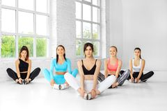 A group of women are engaged in stretching in the gym. The concept of sports, healthy lifestyle, fitness, stretching.  royalty free stock photos