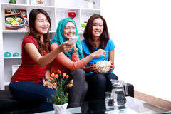 A group of women enjoy watching a movie Royalty Free Stock Image