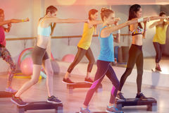 Group of women exercising on aerobic stepper stock photography