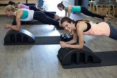 Group of women exercising on arc barrel Royalty Free Stock Photo