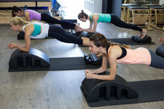 Group of women exercising on arc barrel Royalty Free Stock Photography