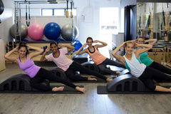 Group of women exercising on arc barrel Royalty Free Stock Images