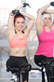 Group of women exercising on cycles Royalty Free Stock Image