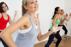 Group Of Women Exercising In Dance Studio. Smiling stock image