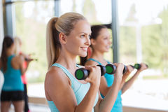 Group of women exercising with dumbbells in gym Royalty Free Stock Photos