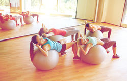 Group of women exercising with fit balls in gym Royalty Free Stock Photography