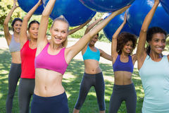 Group of women exercising in park Stock Image