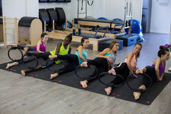 Group of women exercising with pilates ring Royalty Free Stock Image