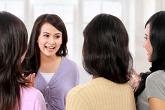 Group of women friends chatting Stock Images