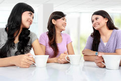 Group of women friends chatting. Over coffee at home Stock Image