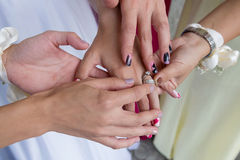 Group of women with hands together Stock Photo