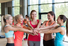 Group of women with hands on top of each other Royalty Free Stock Photo