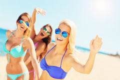 Group of women having fun on the beach Royalty Free Stock Photo