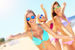 Group of women having fun on the beach Stock Images