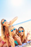 Group of women having fun on the beach Stock Photography