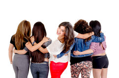 Group of women hugging over a white background Royalty Free Stock Photos